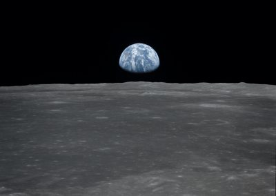 Earth rising over lunar horizon, reference for Aurora